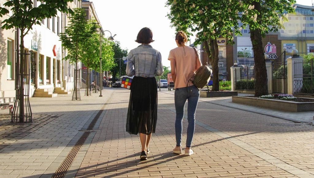 women walking through mixed use developments
